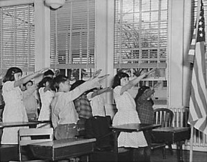 The Bellamy Salute, designed by Francis Bellamy, the author of the Pledge of Allegiance, to be used by American students. It was commonly in practice until 1942 -- for obvious reasons.